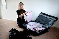 Cecilie packs to go to Kathmandu including baby clothes for Victoria. 19 month old Victoria (formerly named Ghane) was born with hydrocephalus and was left abandoned. Cecilie Hansen was so moved by the story of Ghane she read in a Danish newspaper that she decided to fly to Kathmandu to try to assist her and show her the love of another human being; Cecilie eventually became her legal guardian. Victoria died on November 19 2010 from heart failure.