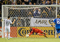 CARSON, CA - August 31, 2013: San Jose Earthquakes goalkeeper Jon Busch (18) just misses blocking the penalty kick from Los Angeles Galaxy forward Robbie Keane (7) during the LA Galaxy vs San Jose Earthquakes match at the StubHub Center in Carson, California. Final score, LA Galaxy 3, San Jose Earthquakes  0.