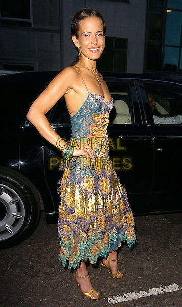 SOPHIE ANDERTON.At the launch of fashion designer Mariella Burani's clothing label, Amuleti J, Pangea, London, .July 14th 2005..full length blue gold see through crochet layered dress layers ruffles nipple breast boob gold shoes green bracelets hand on hip.Ref: CAN.www.capitalpictures.com.sales@capitalpictures.com.©Can Nguyen/Capital Pictures