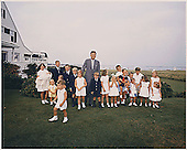 Hyannisport, MA, - Hyannisport Weekend August 3, 1963 -- President Kennedy with children. Kathleen Kennedy (holding Christopher Kennedy) Edward Kennedy Jr., Joseph P. Kennedy II,  Kara Kennedy,  Robert F. Kennedy Jr.,  David Kennedy,  Caroline Kennedy,  President Kennedy, Michael Kennedy,  Courtney Kennedy,  Kerry Kennedy,  Bobby Shriver (holding Timothy Shriver), Maria Shriver, Steve Smith Jr., Willie Smith, Christopher Lawford, Victoria Lawford, Sidney Lawford, Robin Lawford (in foreground- John F. Kennedy Jr.)<br /> Mandatory Credit: Cecil Stoughton - The White House via CNP
