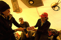 Scientists inside a tent on the Greenland ice sheet celebrating a team member's birthday.