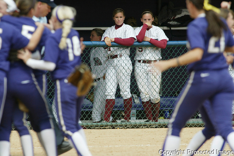 ** SPCL to  Tuscaloosa News and Birmingham News** Alabama's Blair Potter, left, and Jessica Smith watch the Washington team celebrate their 7-5 win in the NCAA Softball Super Regional game Saturday May 26, 2007 in Seattle.  Washington beat Alabama 7-5 to advance to the College World Series. (AP Photo/Jim Bryant).