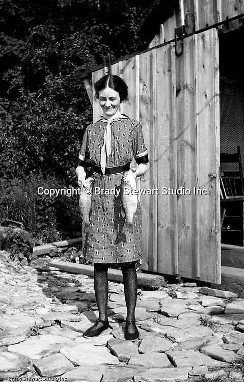 Erie PA:  Sarah Stewart's sister showing off the morning catch before lunch - 1915