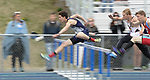 1663<br /> <br /> Eagle River&rsquo;s Mason Wadsworth leads his 110 high hurdles preliminary heat on Friday.  Photo for the Star by Michael DInneen