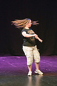 """Katherine Morland, who has Down's Syndrome, rehearsing her dance routine.  Special Olympics Surrey put on a show,   """"Beyond the Stars"""", at the Rose Theatre, Kingston upon Thames to raise money for the  SOGB team.  The Special Olympics are for athletes with learning disabilities."""