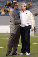 WVU football analyst Hoppy Kercheval and WVU head coach Bill Stewart get together before the game. The West Virginia Mountaineers defeated the South Florida Bulls 20-6 on October 14, 2010 at Mountaineer Field, Morgantown, West Virginia.