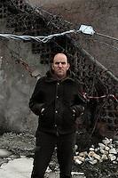 Terremoto del L'Aquila un' anno dopo. Earthquake L'Aquila one year after.Rossano Perilli, davanti le macerie della sua casa..Rossano Perilli in front of the rubble of his house....