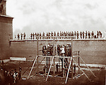 Washington, D.C. Adjusting the ropes for hanging the conspirators. Photograph of Washington, 1865, the assassination of President Lincoln, April-July 1865.Photo by Alexander Gardner, (1821-1882,) SUBJECTS: Surratt, Mary E.; Payne, Lewis; Herold, David E.; Atzerodt, George A..Lincoln, Abraham,--1809-1865.--Assassination..Armories..Hangings..United States--District of Columbia--Washington.