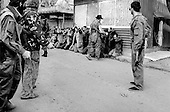 Sukhumi, Abkhazia<br /> September 27, 1993<br /> <br /> As Abkhazian separatists attack Georgian forces held up inside the Parliament, Georgian prisoners are captured and later put on a bus. Within hours the Abkhazians would control the Parliament building and the city.