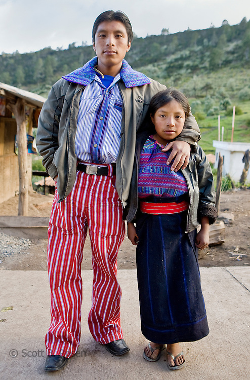 Brother and sister pose in traditional clothing in a village outside Todos Santos Cuchumatan, Western Highlands, Guatemala