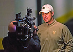2 February 2013: University of Vermont Catamount Head Coach Kevin Sneddon, in his 10th season coaching the Men's Ice Hockey Team, is interviewed by the media during a women's ice hockey game against the University of New Hampshire Wildcats at Gutterson Fieldhouse in Burlington, Vermont. The Lady Wildcats defeated the Lady Catamounts 4-2 in Hockey East play. Mandatory Credit: Ed Wolfstein Photo