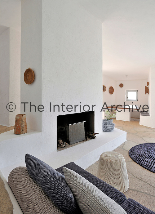 The arrangement of the open plan living area is influenced by the position of the central fireplace