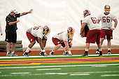 Offensive linemen Morgan Moses (76) of Virginia and Spencer Long (60) of Nebraska, both of whom were drafted in the third round of the recent NFL draft, participate in a drill during the Washington Redskins' rookie minicamp at Redskins Park in Ashburn, Virginia on Saturday, May 17, 2014.  Also pictured are Trevita Stevens (62) of Utah and Steve Greene (66) of UConn.<br /> Credit: Ron Sachs / CNP
