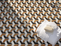 Francois, a waterjet mosaic shown in polished Saint Laurent, Calacatta Tia, and Topaz Onyx, is part of the Illusions™ Collection by Sara Baldwin Designs for New Ravenna.