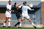 27 November 2009: North Carolina's Tobin Heath (98) holds off Wake Forest's Bianca D'Agostino (in black) as Jessica McDonald (47) watches. The University of North Carolina Tar Heels defeated the Wake Forest University Demon Deacons 5-2 at Fetzer Field in Chapel Hill, North Carolina in an NCAA Division I Women's Soccer Tournament Quarterfinal game.