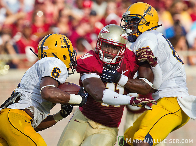 Murray State's Nevar Griffin is unsuccessful at blocking FSU's linebacker Vince Williams from tackling Duante Brady (6) when the Florida State Seminoles defeated the Murray State Racers 69-3 in their first NCAA football game of the 2012 season at Doak Campbell Stadium on the FSU campus in Tallahassee, Florida September 1, 2012.