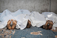 In this Saturday, Jul. 27, 2013 photo, dead bodies are seen lying on the floor of a field hospital after they were killed during a fighting with police forces in the nearby streets of Rabaa Al-Alawya mosque in the Nasr City neigbourhood of Cairo. (Photo/Narciso Contreras).