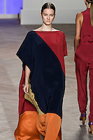 Jac walks the runway in a navy/red/orange/mustard color block silk kaftan, by Tommy Hilfiger for the Tommy Hilfiger Spring 2012 Pop Prep Collection, during Mercedes-Benz Fashion Week Spring 2012.
