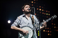 "Winston Marshall plays the banjo during the hit ""Little Lion Man,"" from Mumford & Sons' debut album Sigh No More at the Susquehanna Bank Center on February 16, 2013."
