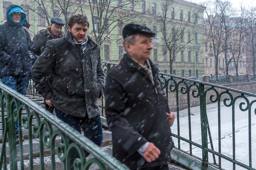 ST. PETERSBURG - CIRCA MARCH 2013:  People walking during a snow storm in St. Petersburg, circa March 2013. This is a tourist attraction with 221 museums, 2000 libraries, and 80  plus theaters within the city.