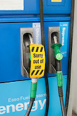 """Out of Use"" sign on petrol pump."