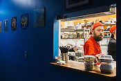 Raleigh, North Carolina - Thursday November 12, 2015 - Drew Kirk works the expo and garnish station at Fiction Kitchen in Raleigh.