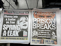 New York tabloid newspapers on Wednesday, January 18, 2017 report on President Barack Obama's end of term pardons for Wikileaks spy Chelsea Manning and 1970's Puerto Rican terrorist Oscar Lopez Rivera.  (© Richard B. Levine)