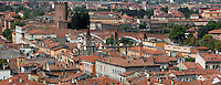 Panoramic view of rooftops and Castelvecchio, 1354-79, Verona, Italy, seen from Castel San Pietro, known by the Romans as Mons Gallus. The castle, built with its bridge, for Cangrande II,  stands on the probable site of a Roman fortress. The castle, where Napoleon stayed, was damaged  during the Pasque Veronesi, Napoleonic Wars (1796-97). Castelvecchio was restored in 1923 and 1963-65. Picture by Manuel Cohen.