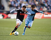 Paulo Nagamura (6) of Sporting Kansas City fights for the ball with Michael Farfan (21) of  the Philadelphia Union during the game at PPL Park in Chester, PA.  Kansas City defeated Philadelphia, 3-1.
