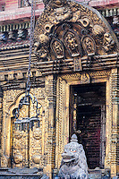 Nepal, Changu Narayan Temple, Western Entrance, before April 2015 earthquake.  The temple was heavily damaged in the earthquake, but will be repaired.  This shows the torana, the elaborate brass gateway to the temple, with images of Vishnu over the doorway.