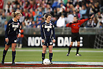 03 December 2010: Notre Dame's Elizabeth Tucker (8) and Lauren Fowlkes (9) start the game as referee Dan Radford (in red) blows his whistle. The Notre Dame Fighting Irish defeated the Ohio State University Buckeyes 1-0 at WakeMed Stadium in Cary, North Carolina in an NCAA Women's College Cup semifinal game.