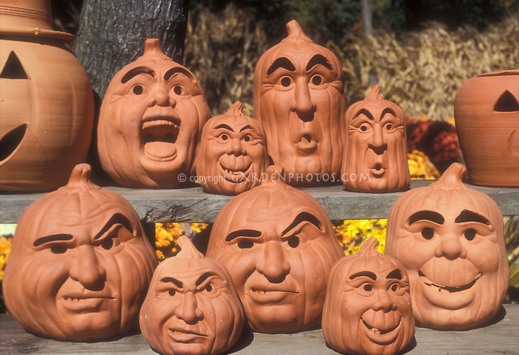 Halloween Pumpkin Decorations - variety of clay terra cotta pottery Jack O'Lantern faces and heads in autumn