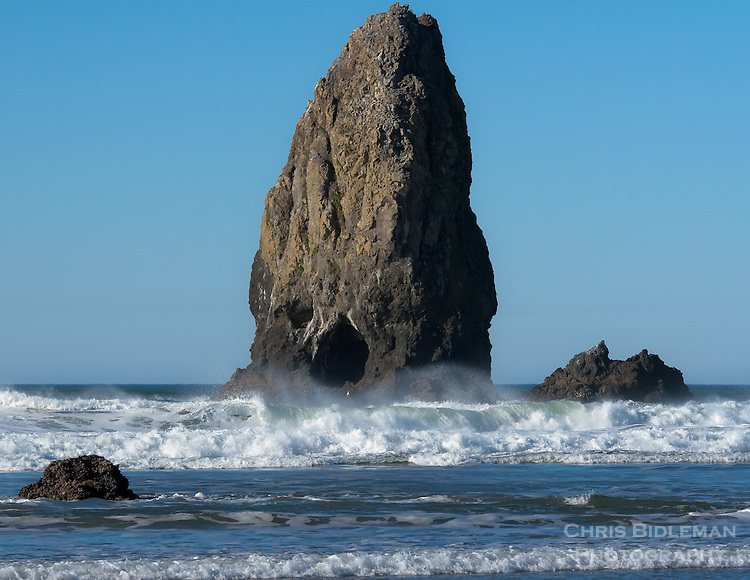 Gift card photo of The Needles in Cannon Beach near Haystack Rock on a blue sky day with waves rolling in