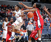 Dec. 6, 2010; Charlottesville, VA, USA; Virginia Cavaliers guard Ariana Moorer (15) passes the ball in front of Radford Highlanders forward Ciara Hayes (2) and Radford Highlanders guard Breshara Gordon (12) at the John Paul Jones Arena. Virginia won 76-52. Mandatory Credit: Andrew Shurtleff