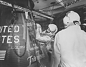 "Project Mercury astronaut John H. Glenn, Jr., enters the ""Friendship 7"" spacecraft during the last part of the countdown on February 20, 1962. At 9:47 a.m., (EST), the Mercury Atlas 6 (MA-6) launch vehicle lifted the spacecraft into orbit for a three-orbit mission lasting 4 hours, 55 minutes and 23 seconds. Glenn and his spacecraft were recovered by the destroyer NOA just 21 minutes after landing in the Atlantic Ocean near Grand Turk Island, to successfully complete the nation's first manned orbital flight..Credit: NASA via CNP"