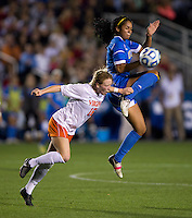 Darian Jenkins (11) of UCLA fights for the ball with Emily Sonnett (16) of Virginia during the Women's College Cup semifinals at WakeMed Soccer Park in Cary, NC. UCLA advance on penalty kicks after typing Virginia, 1-1 in regulation time.
