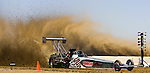 Geoff Gill races his top-fuel dragster at the National Sand Drad Race Association's 2009 Summer Nationals in Avenal, CA May 17, 2009.