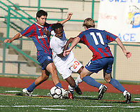 Alan Sanchez #18 and Dan Lader #11 of Crystal Palace Baltimore move in on Gregory Richardson #20 of the Carolina Railhawks during an NASL match at Paul Angelo Russo Stadium in Towson, Maryland on September 18 2010.