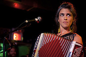 Beth Tacular of the Bowerbirds plays the accordian during their set at the Pour House during the Hopscotch Music Festival in Raleigh, N.C., Friday, Sept. 10, 2010.