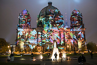 The Berliner Dom at the festival of light shot on a misty night to show the beams of light better.