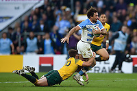 Marcelo Bosch of Argentina is tackled by Bernard Foley of Australia. Rugby World Cup Semi Final between Argentina v Australia on October 25, 2015 at Twickenham Stadium in London, England. Photo by: Patrick Khachfe / Onside Images