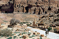 Jordan. Petra.The archeological site is part of the UNESCO world heritage project.  The Nabataeans were an arabian industrious tribe which settled down in southern Jordan 2000 years ago. Petra is located at the bottom of a spectacular deep gorge surrounded by mountains. At the end of columns alley, the various king tombs are carved in the mountains. A young boy seated on a dunkey waits for the tourists.  © 2002 Didier Ruef