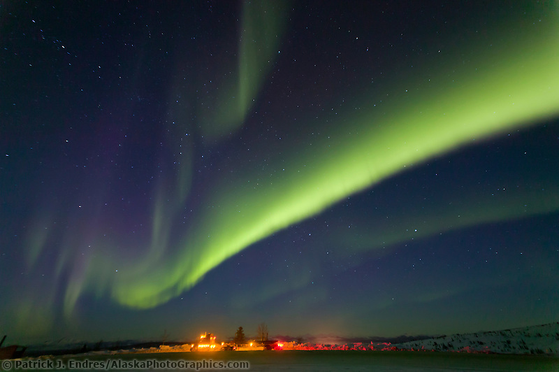 Aurora borealis swirls across the sky over interior Alaska, Truck parked at Gobler's Nob turnout on the Dalton Highway.