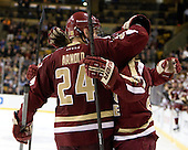 Bill Arnold (BC - 24), Quinn Smith (BC - 27) - The Boston College Eagles defeated the Harvard University Crimson 4-1 in the opening round of the 2013 Beanpot tournament on Monday, February 4, 2013, at TD Garden in Boston, Massachusetts.