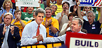 May 17,  2004 -Presidential candidate John Kerry (center) makes a stop in Portland with former Governor Howard Dean )right) at his side. The two were treated to a huge welcoming crowd at Pioneer Square and even supported on the stand by friends, actors and musicians...KEYWORDS: election, president