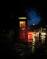 """A phone box in Highgate, North London where 28 year old Hamid from Iran used to shelter in the years he spent living on the streets. """"When you're sleeping outside one night feels like one year because it's so cold. I never managed to sleep for more than an hour or two and when it's raining it's hard to sleep for more than fifteen minutes at a time."""" Hamid is one of an estimated 300,000 rejected asylum seekers living in the UK."""