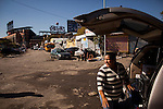 QUEENS, NY -- OCTOBER 21, 2013:  Rosa Guaman, 31, sells food and drinks from the back of a van on Willets Point Blvd in Willets Point on October 21, 2013 in Queens.  Photographer: Michael Nagle for The New York Times