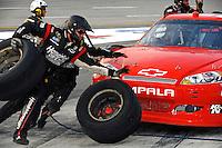The Phoenix crew preforms a pit stop.
