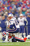 New England Patriots wide receiver Troy Brown (80) makes a reception before being tackled by cornerback Eric King (29) in a gain against the Buffalo Bills at Ralph Wilson Stadium in Orchard Park, NY, on December 11, 2005 . The Patriots defeated the Bills 35-7. Mandatory Photo Credit: Ed Wolfstein