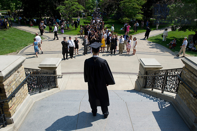 May 20, 2012; A graduate poses for photos on the steps of the Main Building, Commencement 2012. Photo by Barbara Johnston/University of Notre Dame